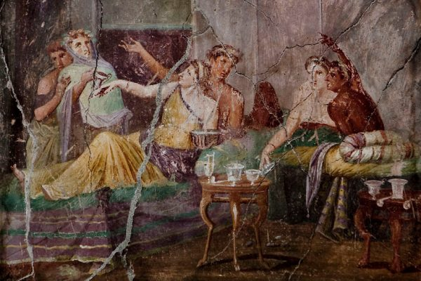 Roman fresco with banquet scene inside the House of Chaste