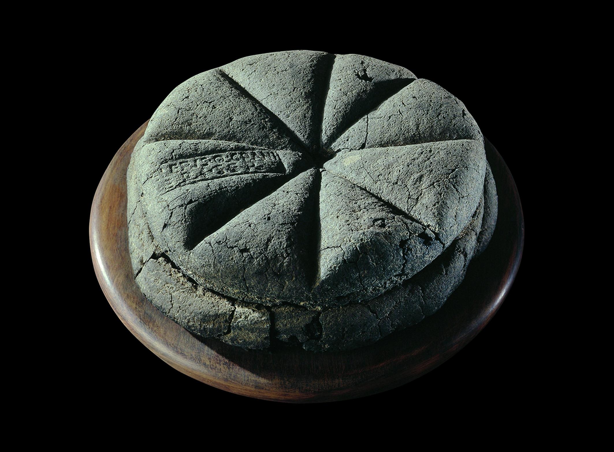 Romeins brood, panis quadratus, met stempel slaaf